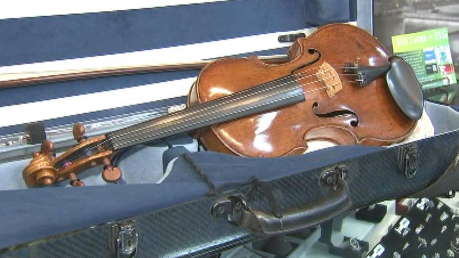Violin sold in a Massachusetts pawn shop for $50 turns out to be stolen and worth about $250,000.