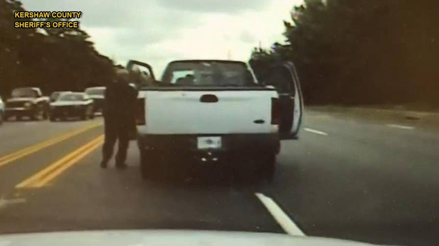 A police officer in South Carolina went above and beyond by chasing down a truck on foot to save the unconscious driver behind the wheel.