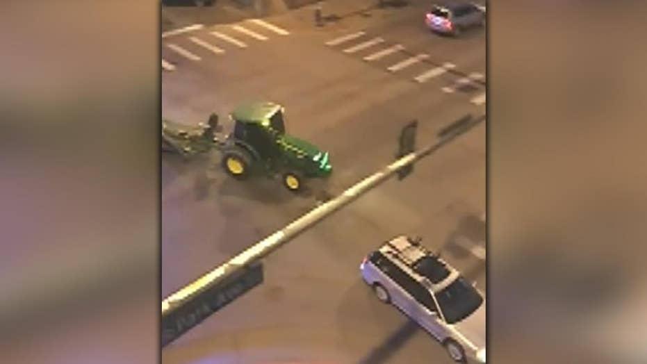 Raw video: Police pursue tractor through Denver