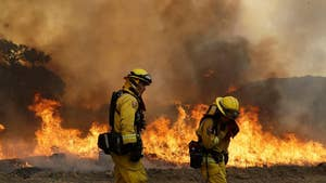 Firefighters hoping for more favorable weather conditions as flames spread.
