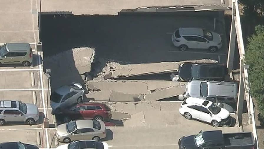 Parking garage collapse in Irvine, fire department says no one inside of smashed cars.