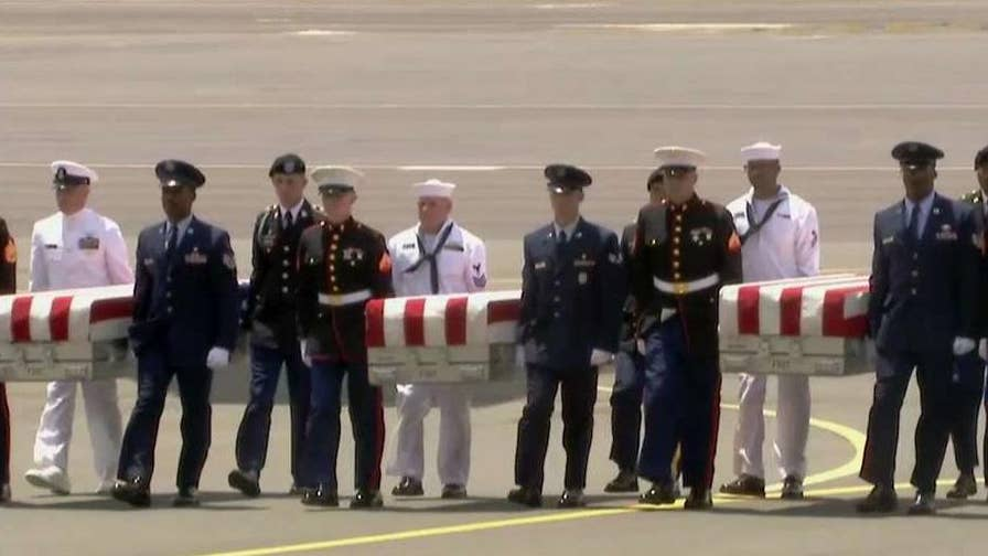 Honorable carry ceremony held in Hawaii to welcome apparent remains of United States soldiers from North Korea.