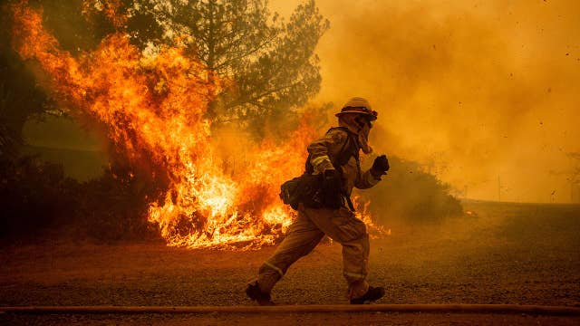Firefighters battle more than a dozen wildfires in Calif.