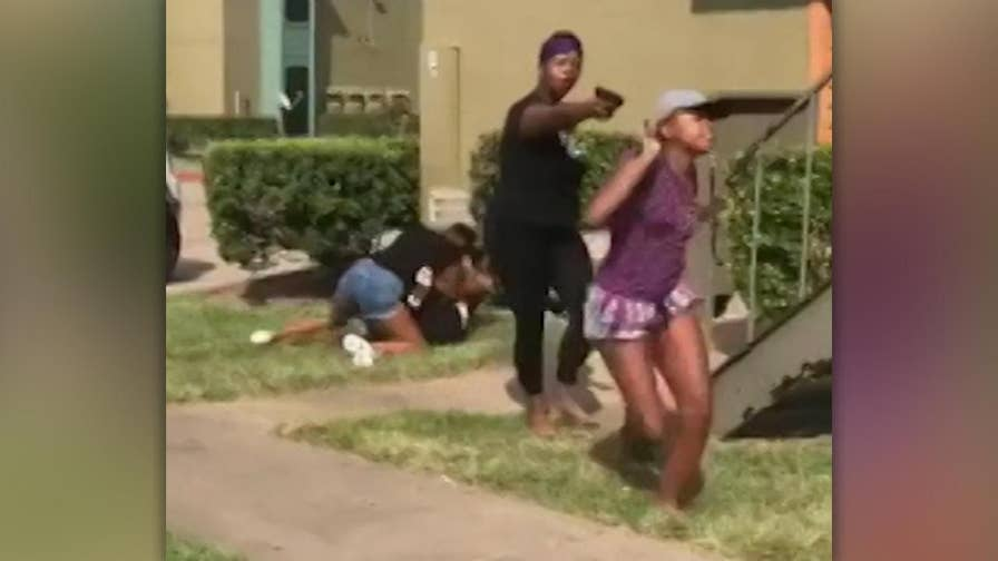 Raw video: Mother says she pulled a BB gun during daughter's fight with a teenage girl who arrived with a large group who had a knife.