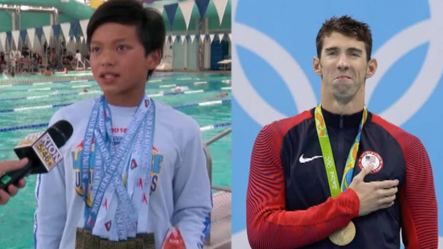 10-year-old swimmer Clark Kent Apuada from California broke a swimming record in the 100-meter butterfly that Olympic legend Michael Phelps set 23 years ago.