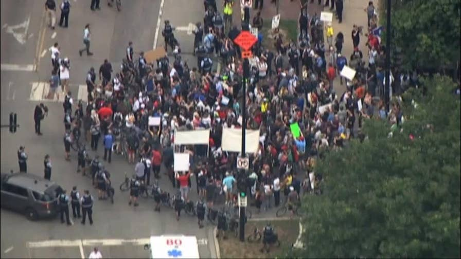 Chicago protesters marched to Wrigley Field to raise awareness of the city's crime crisis.