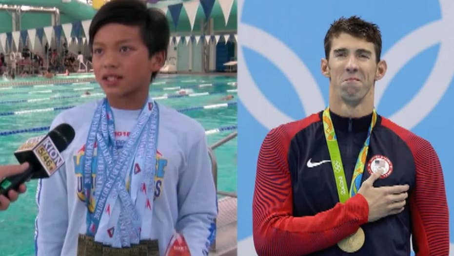 10-year-old swimmer beats record Michael Phelps held for 23 years