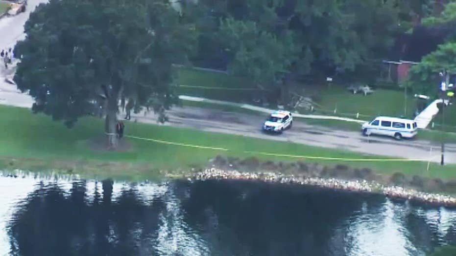 Raw video: Divers search for girl reportedly thrown in river