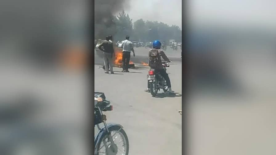 Video shows protests in Iran against government corruption and the state of the economy.