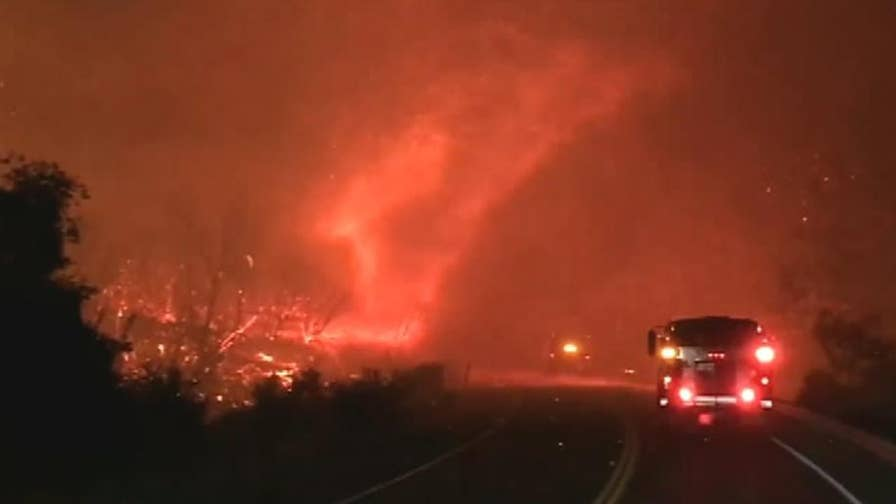 Fire tornado caught on camera by firefighters amid California's Carr fire.