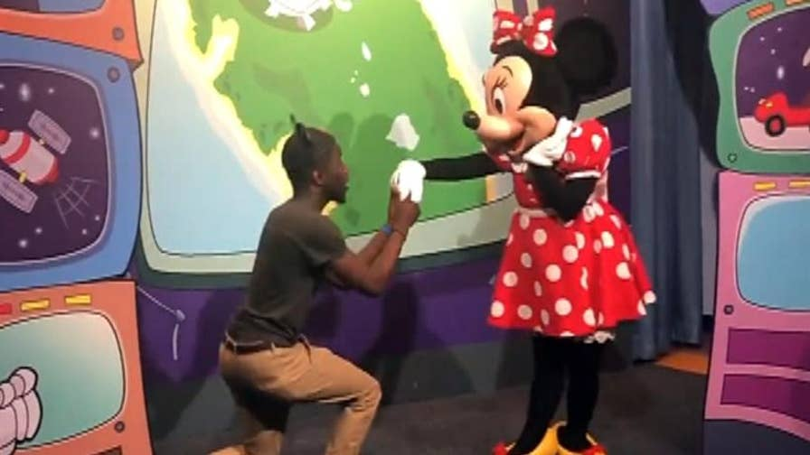 Scandal struck at the happiest place on earth, when a gleeful Minnie Mouse accepted a man's marriage proposal to the shock of Mickey Mouse.