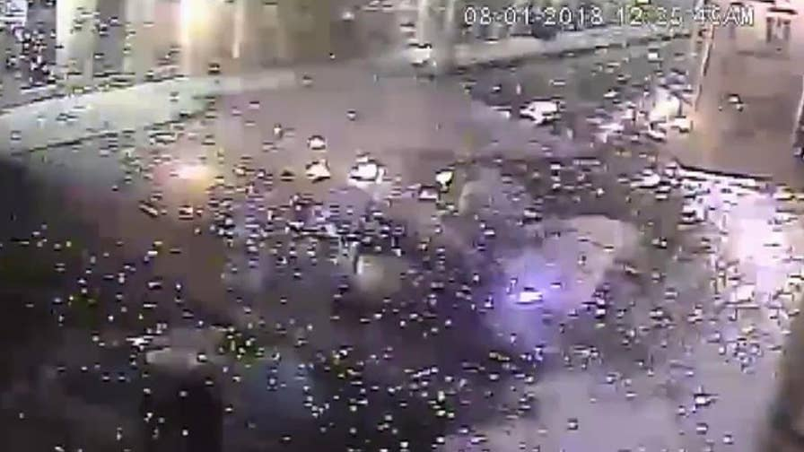 Police search for suspects that threw fireworks from moving car.