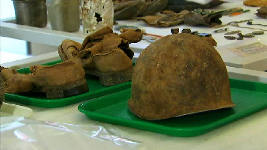 Military artifacts found among remains returned by NKorea