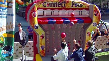 Fantasy World Entertainment brings a carnival atmosphere to the Fox News plaza.