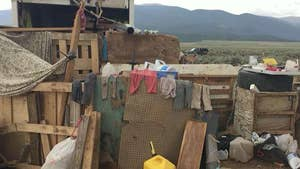 11 children rescued from heavily-armed compound built out of garbage.