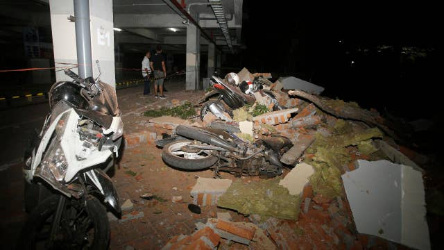Indonesia earthquake leaves at least 82 dead