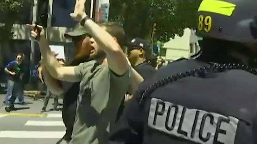 Violent clashes erupt between far-right and far-left protesters in California.