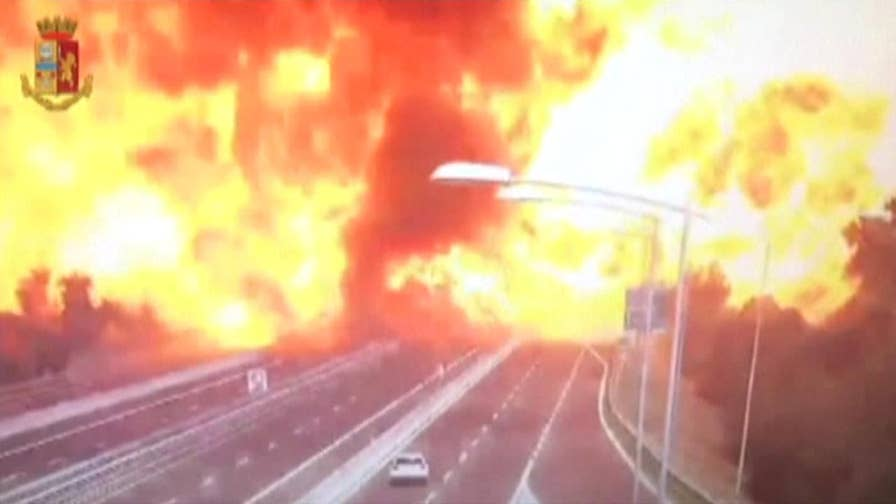 Police say a tanker truck carrying flammable material exploded in the Italian city of Bologna after it was rear-ended by another semi.