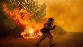 California authorities late Monday said a firefighter died battling the massive Mendocino Complex fires that have burned 336,399 acres in the state.