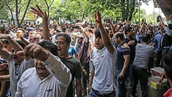 A look at why people are gathering in the streets and protesting across Iran