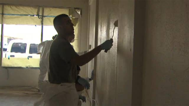 Army National Guard members clean home for homeless vets