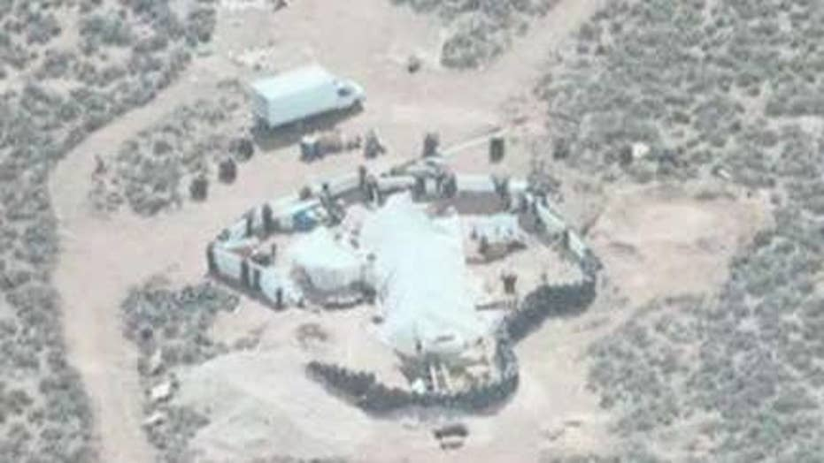 Authorities raid New Mexico compound, rescue 11 children