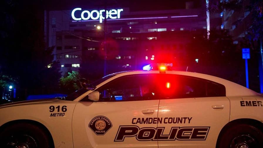 Two New Jersey detectives wounded after suspect fired as many as 25 rounds into their vehicle in Camden.