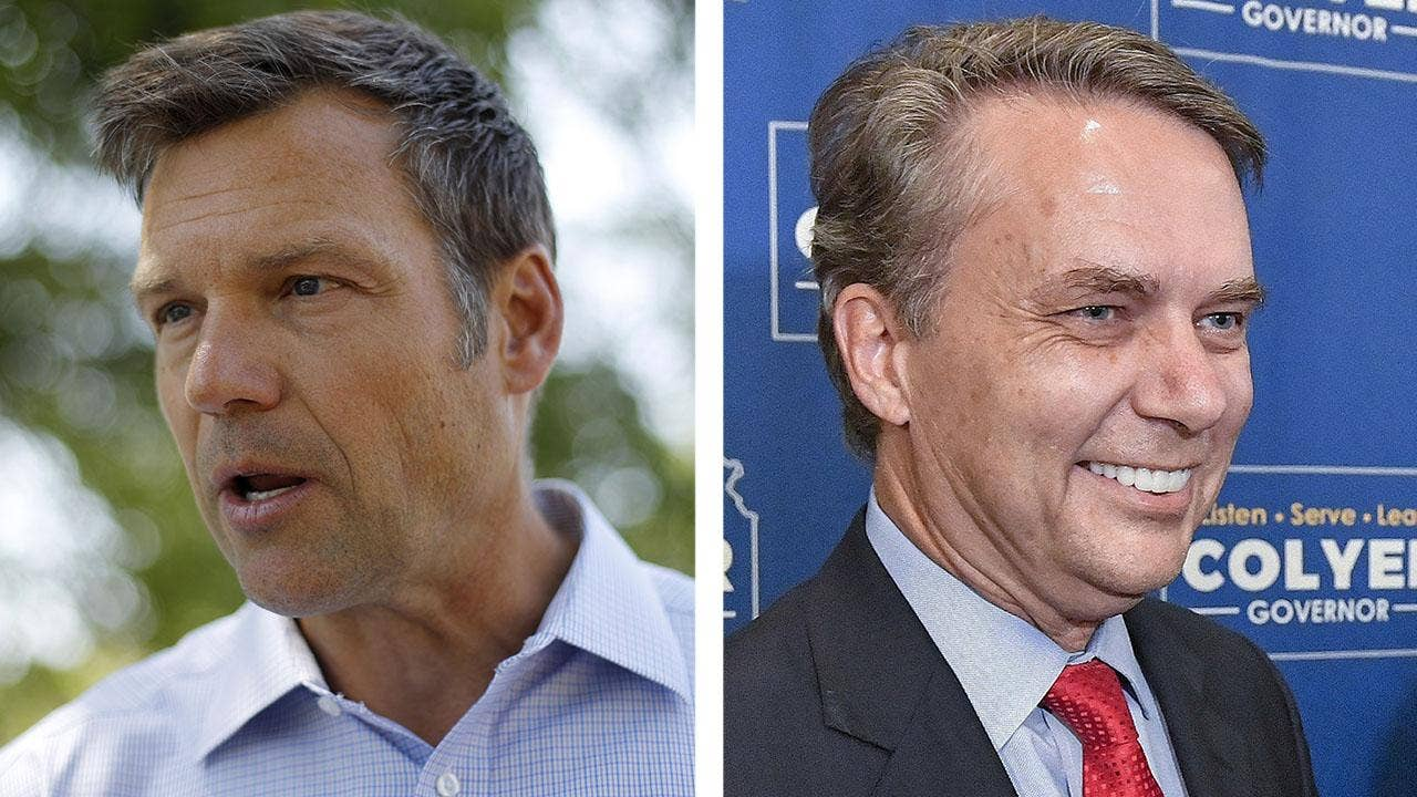 photo image Kobach recuses himself as Kansas' top election official as he clings to lead in governor's race