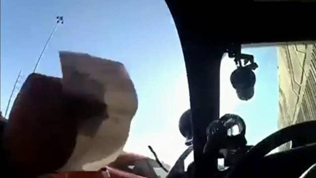 Raw video: Driver slams into Nevada trooper's car door