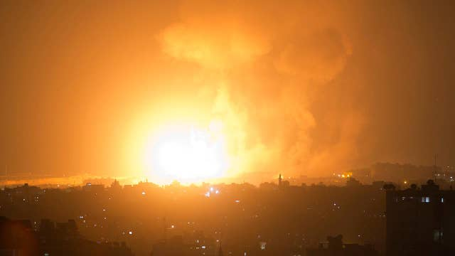 Israel launches airstrikes as militants fire 180 rockets
