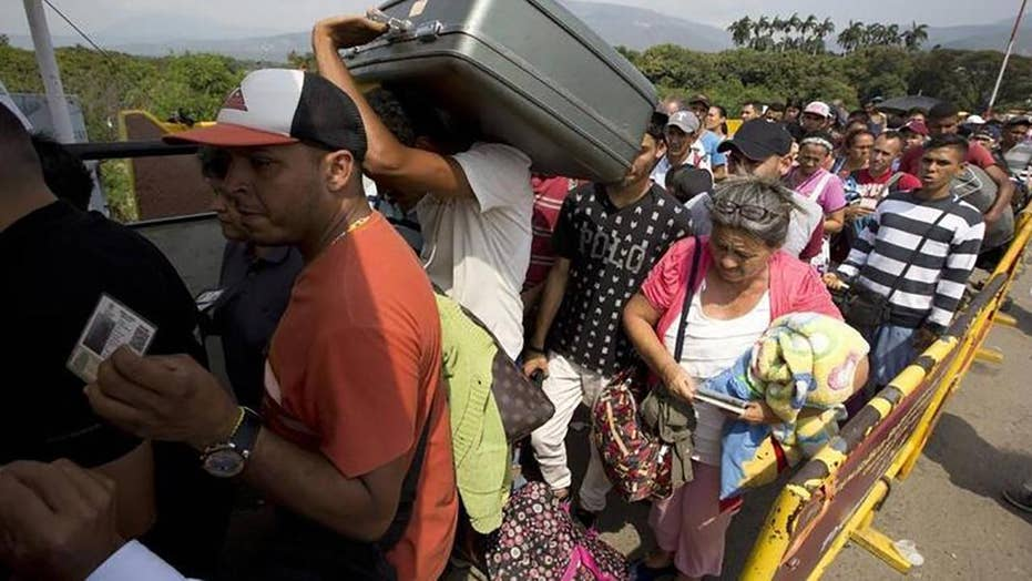 Venezuelans flee country in crisis
