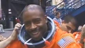 NASA astronaut Leland Melvin claims he once saw an 'alien-like, organic object' floating outside his space shuttle.