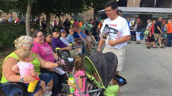 As the weeks go on Mollie Tibbetts' father and boyfriend turn to fairgoers for help