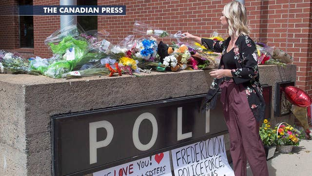 Two officers among four killed in New Brunswick rampage