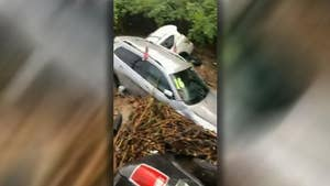 Raw cell phone footage shows several cars that were swept into a river from their lot in Little Falls, New Jersey.