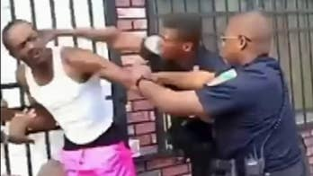Raw cell phone video filmed by local rapper Yung Inkky shows a Baltimore officer beating a man and pushing him to the ground.