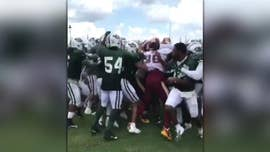 New York Jets and Washington Redskins players were involved in a massive brawl during their joint practice session Sunday, which spilled into where the fans were standing.