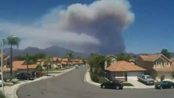 A California man's home security system captured the smoke rising above the horizon as the Holy Fire spread.