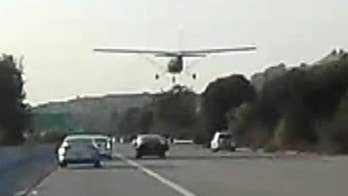 Pilot reported engine problems before landing the single-engine Cessna plane on busy interstate in San Leandro. No reports of accidents or injuries in the incident.