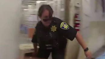 Raw video: An officer in the Vacaville Police Department rescue dogs from an animal shelter as the Nelson Fire closes in on the building.