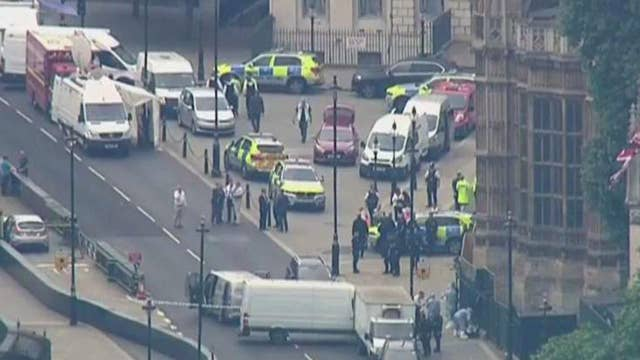 Car crashes into barrier outside UK Parliament