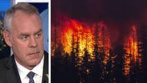 Interior Secretary Ryan Zinke gets firsthand look at California wildfires, urges more active resource management of nation's forests.
