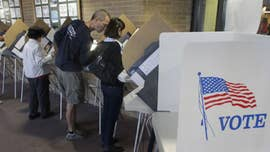 "Voters in Minnesota, Wisconsin, Connecticut and Vermont cast ballots in primaries Tuesday, as predictions of a ""big blue wave"" driven by anti-Trump sentiment are dissipating."