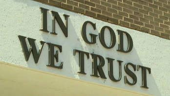 Blount County school system to become one of the first to act on a new law allowing the 'In Got We Trust' motto to be displayed on school property; Superintendent Rodney Green defends the move on 'Fox & Friends.'