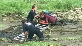Raw Video: The Belleville Fire Department rescue a man who became trapped waist deep in mud while trying to rescue his pet parrot.