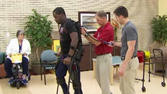 Exoskeleton suit helps paralyzed Navy veteran walk again