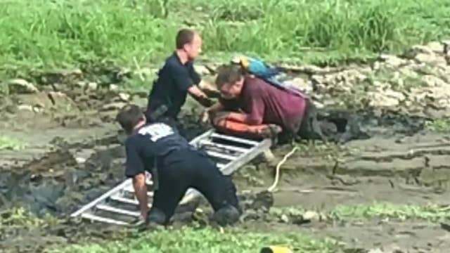 Man with parrot on his shoulder rescued from mud