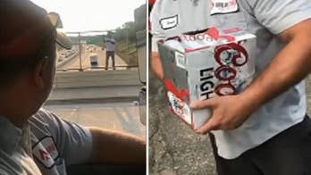 A pair of Minnesota beer delivery men spotted what looked like a suicidal man on a bridge and talked him back by offering him a beer from their truck.