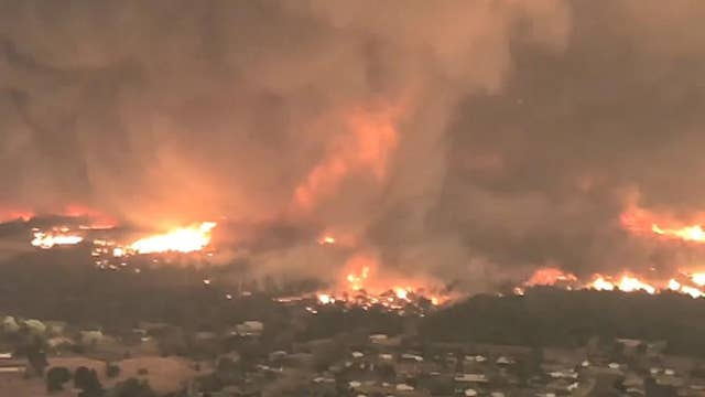 Massive fire tornado tears through Redding, Calif.