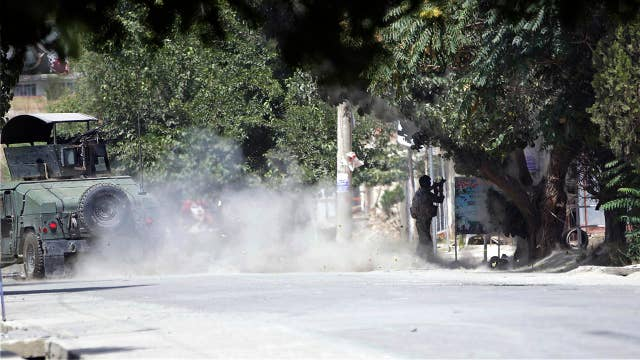 Gunmen storm Afghan intel compound in Kabul